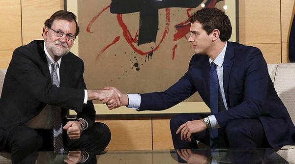 Blocajul politic din Spania, tot mai aproape de final. Rajoy și Rivera și-au dat mâna